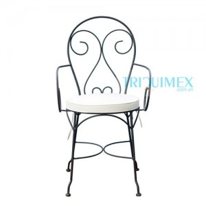 wrought iron chair with iron seat and artistic patterns
